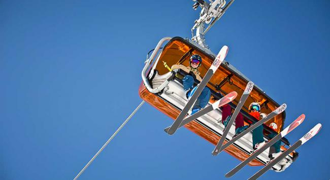 People on a ski chairlift