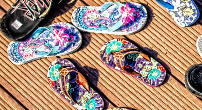 Sandals on a wooden deck