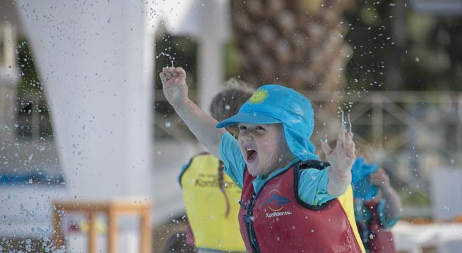 A child playing in a lifevest