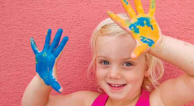 A child with paint on their hands