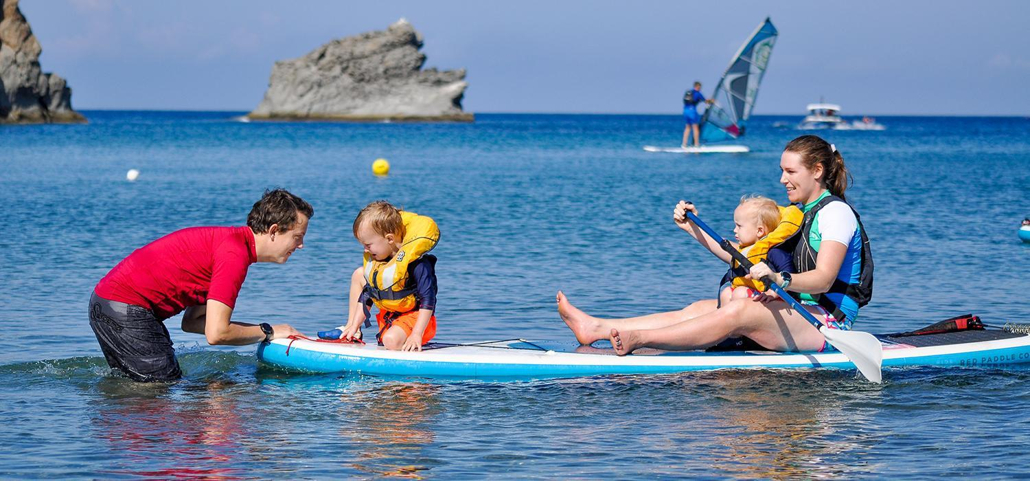 Family on stand up paddle board