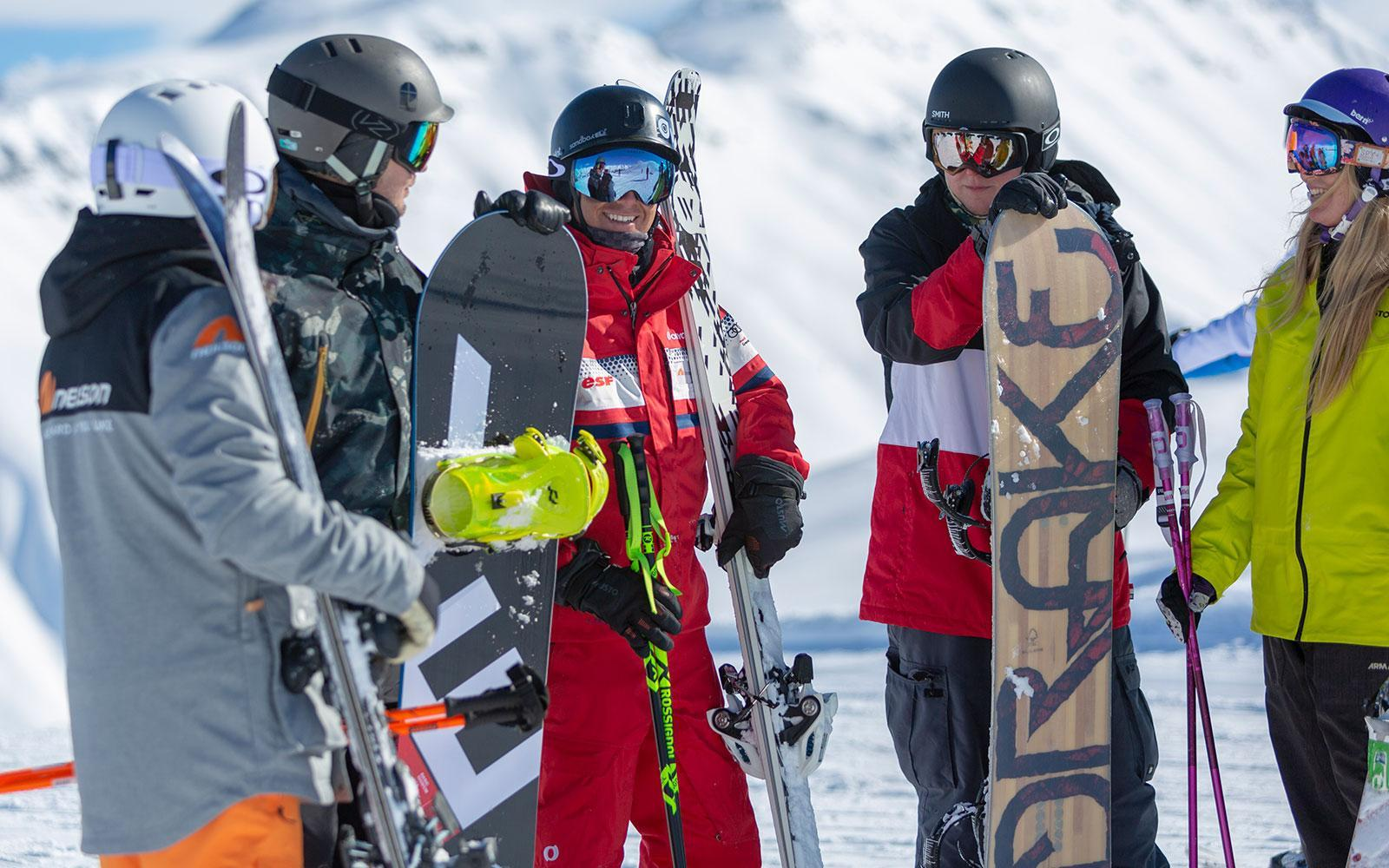 group of skiers and snowboarder