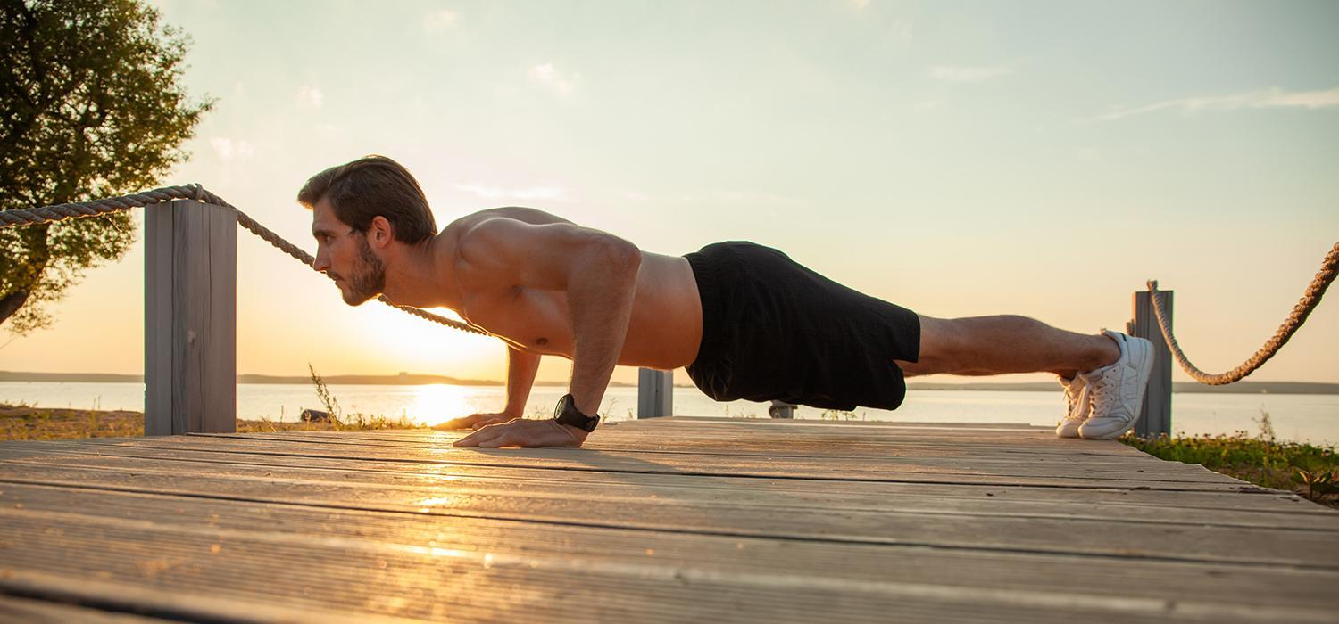 man doing push ups outdoors
