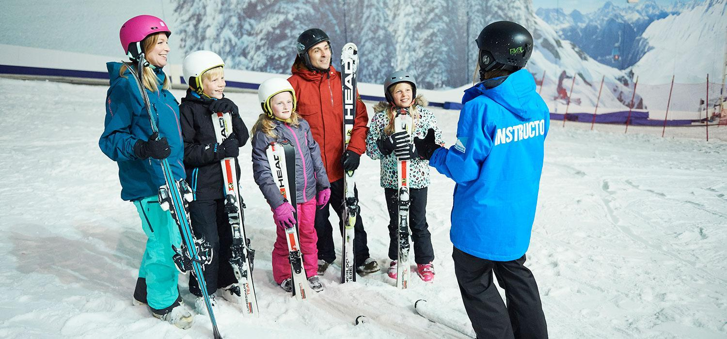 family learning to ski