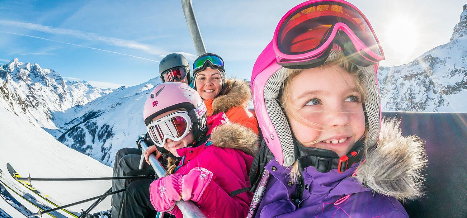 family on a ski lift