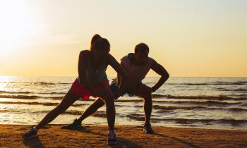 Couple exercising on the beach