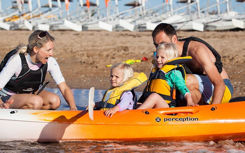 mum and dad in kayak with two young children